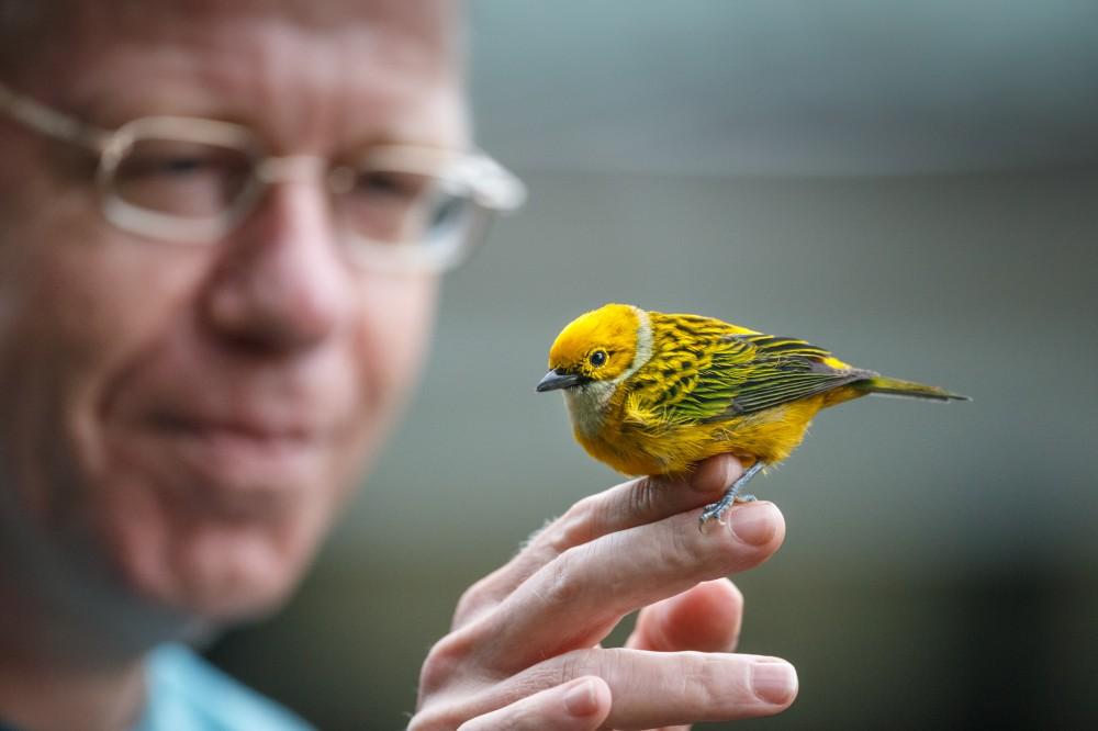 Man Holding Bird