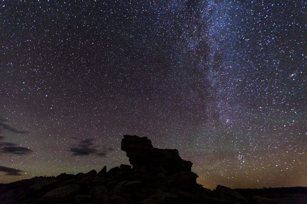 Castle Rock with night sky and stars, Vermejo Park Ranch, New Mexico, USA.
