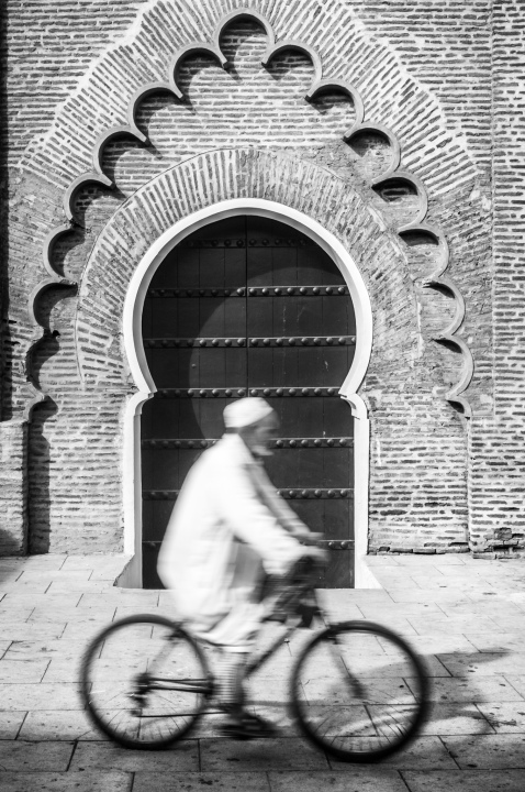 Biking past Doorway
