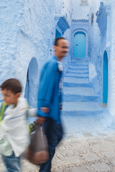 Walking Past Blue Walls and Staircase