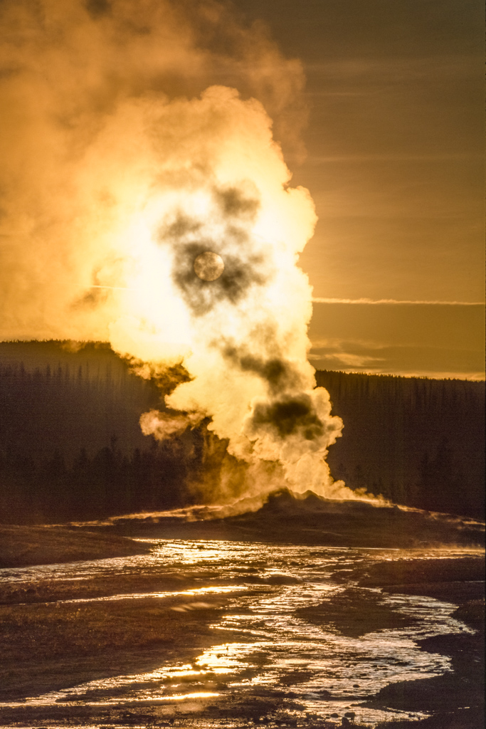 Old Faithful at sunrise, Yellowstone National Park, Wyoming, USA.