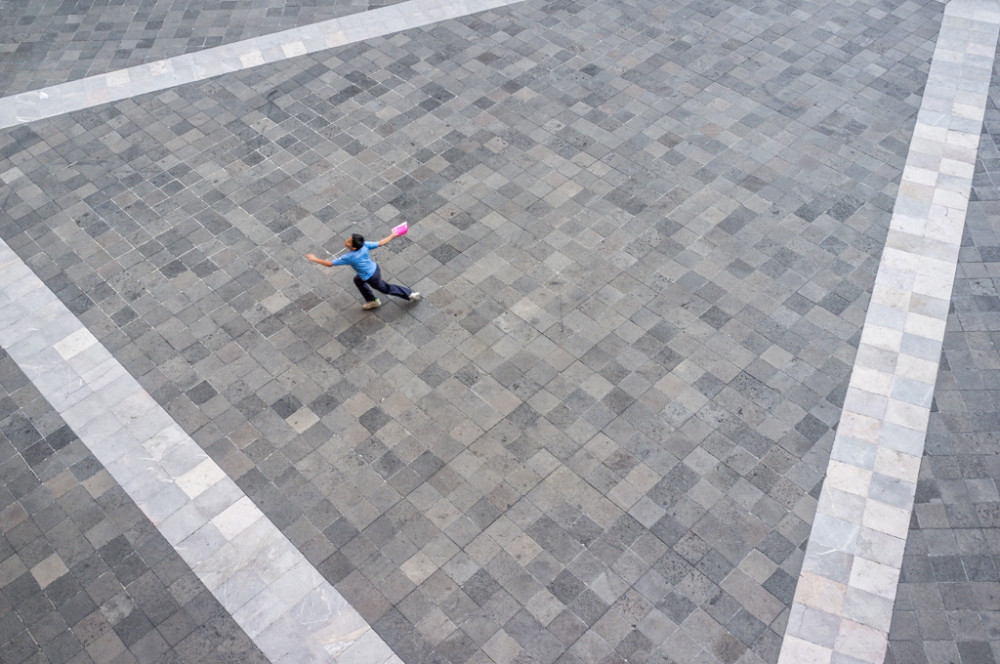Boy running in courtyard, National Palace, Mexico City, Federal District, Mexico.