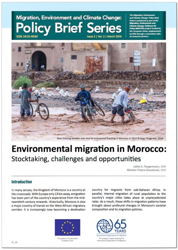 International Organization for Migration (IOM) Policy Brief, Vol. 2 Issue 3 cover photo by Sean Fitzgerald of People pushing bikes across flooding river at Kasbah Amridil, Skoura, Morocco