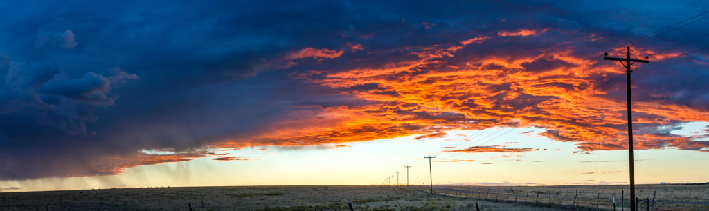 Panorama of telephone poles on prairie at sunset, Rita Blanca National Grasslands in Texas Panhandle, Texas, USA. (Stitched Panorama from multiple images).
