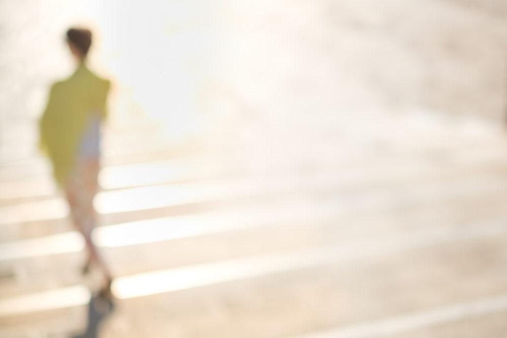Abstract lady in yellow strolling on Riva degli Schiavone promenade near Palazzo Ducale, Venice, Venezia, Italy