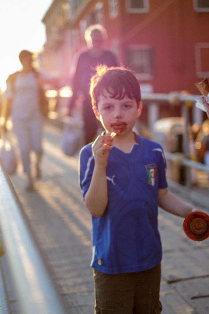"Young boy eating chocolate gelato on ""evening stroll"" along Fondamenta Zattere, Dorsoduro, Venice, Venezia, Italy."